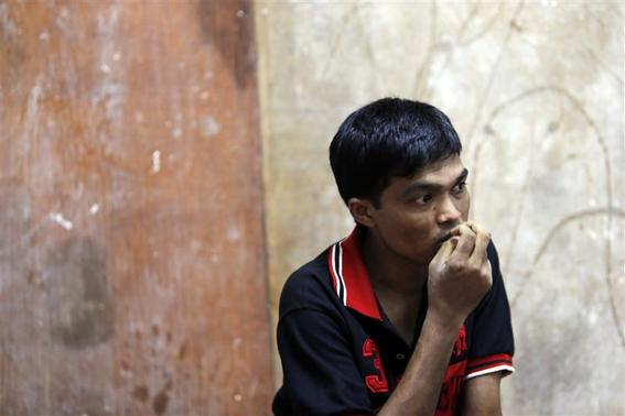 Bozor Mohammed from the Rakhine state in Myanmar listens during an interview at his house in Kuala Lumpur November 8, 2013. Picture taken November 8. REUTERS-Samsul Said