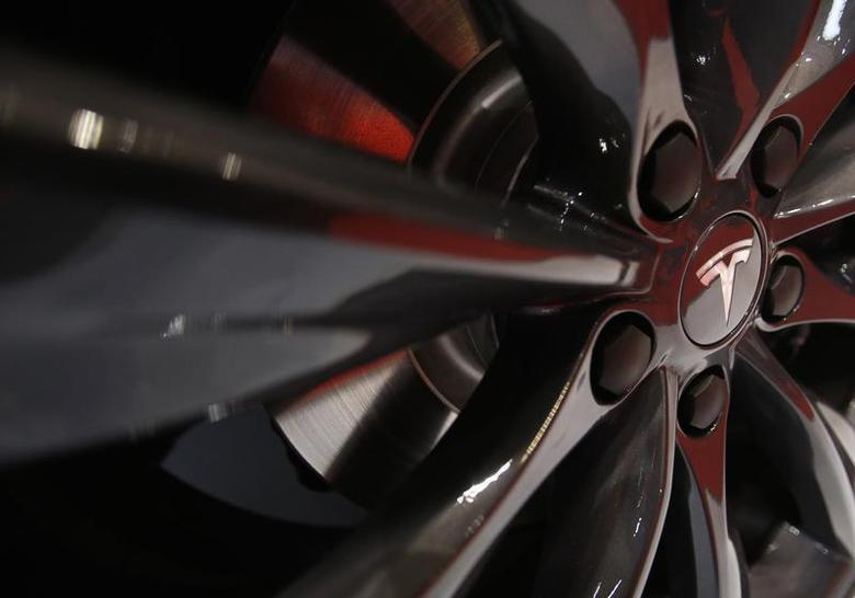 A logo of Tesla Motor Inc is seen on the wheel of its Model S car, on display at the 43rd Tokyo Motor Show November 20, 2013. REUTERS/Yuya Shino