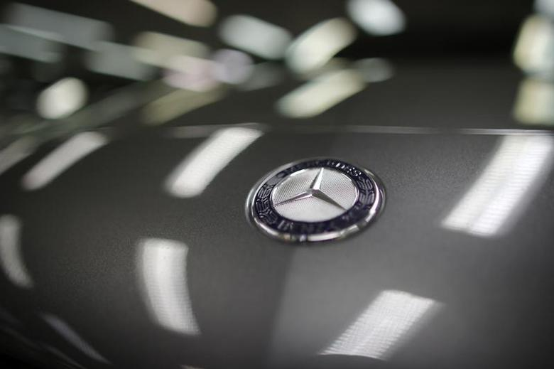 A company logo is seen on a Mercedes-Benz A-class car displayed in a dealership of German car manufacturer Daimler in Paris, July 30, 2013. REUTERS/Christian Hartmann