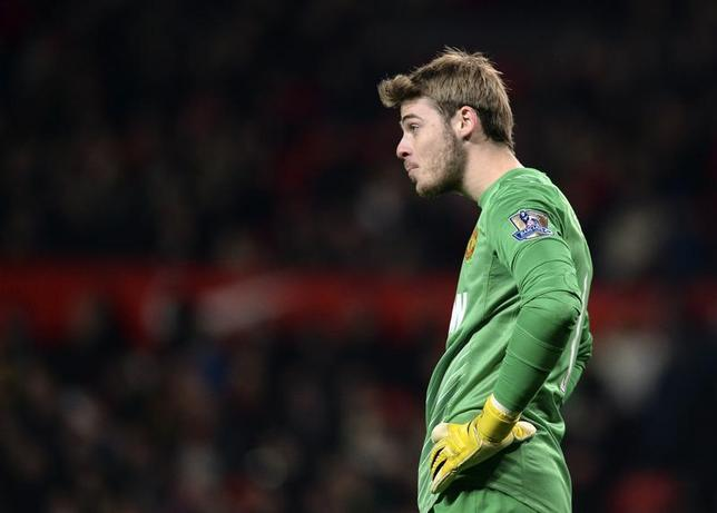 Manchester United's David De Gea reacts during their English Premier League soccer match against Everton at Old Trafford in Manchester, northern England December 4, 2013. REUTERS/Nigel Roddis