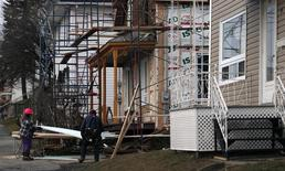 Construction workers work on a house in Lac-Megantic, November 21, 2013. REUTERS/Mathieu Belanger