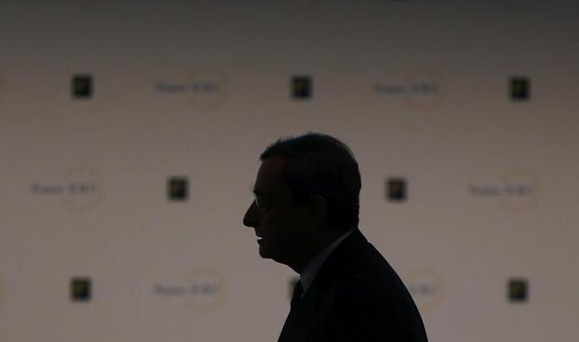 Mario Draghi, President of the European Central Bank (ECB) is silhouetted arrives for the European Banking Congress, at the old opera house in Frankfurt, November 22, 2013. REUTERS/Kai Pfaffenbach