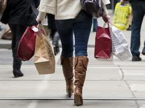 A woman carries shopping bags during the Christmas shopping season in Toronto, December 7, 2012. REUTERS/Mark Blinch