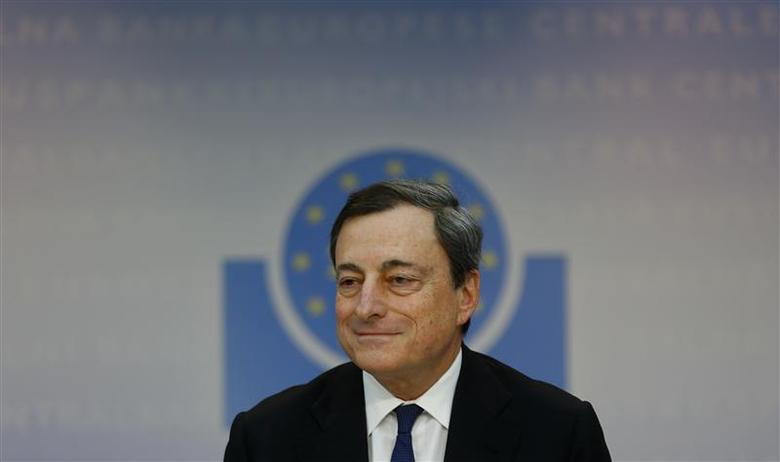 Mario Draghi, President of the European Central Bank (ECB) answers reporter's questions during his monthly news conference at the ECB headquarters in Frankfurt, December 5, 2013. The ECB announced that interest rates will be unchanged. REUTERS/Kai Pfaffenbach
