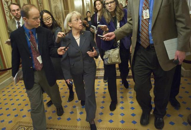 U.S. Senator Patty Murray (D-WA) (C), co-chairman of the 'super committee' on debt reduction, speaks to reporters after meeting with the Democratic members of the committee at the U.S. Capitol in Washington November 16, 2011. REUTERS/Jonathan Ernst