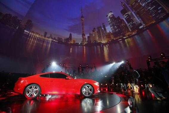 Ford Motor Co. unveils its 2015 Ford Mustang in Shanghai December 5, 2013. REUTERS/Aly Song