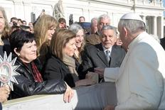 Pope Francis (R) greets U.S. singer Patti Smith (C) at the end of his weekly general audience at St. Peter's Square at the Vatican December 4, 2013. REUTERS/Osservatore Romano