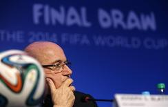 FIFA President Sepp Blatter listens to a question during a news conference ahead of the 2014 World Cup draw at the Cost. The draw will be held on December 6. REUTERS/Sergio Moraes