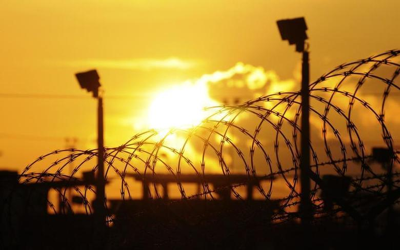 The sun rises over the U.S. detention center ''Camp Delta'' at US Naval Base Guantanamo Bay in Cuba October 18, 2012 in this photo reviewed by the U.S. Department of Defense. REUTERS/Michelle Shephard/Pool