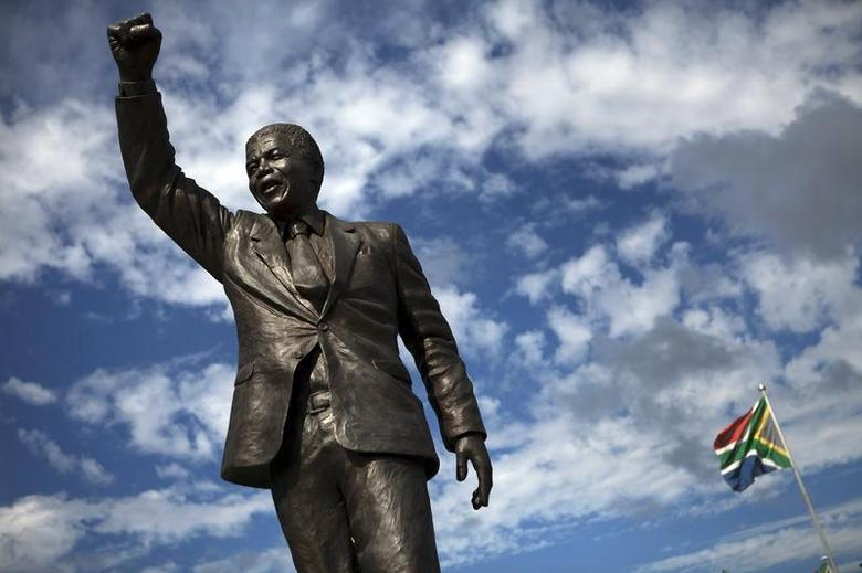 A statue of Nelson Mandela stands outside the gates of Drakenstein Correctional Centre (formerly Victor Verster Prison), near Paarl in Western Cape province February 10, 2010. REUTERS/Finbarr O'Reilly/Files
