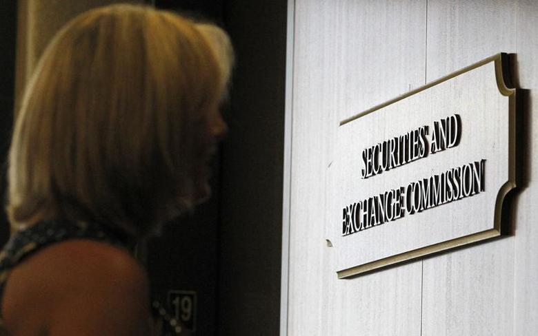 A woman waits for an elevator in the foyer of the Fort Worth Regional Office of the Securities and Exchange Commission (SEC) in Fort Worth, Texas June 28, 2012. Picture taken June 28, 2012. REUTERS/Mike Stone