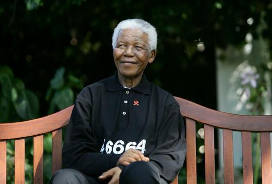 File photo of Nelson Mandela smiling at a news conference ahead of the second 46664 concert near the small Southern Cape province town of George. REUTERS-Mike Hutchings-Files