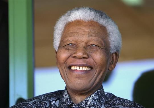 Nelson Mandela smiles as he watches the coronation ceremony of Bafokeng's King Leruo Tshekedi Molotlegi at a sports stadium in Phokeng, 120 km (81 miles) north of Johannesburg, in this August 16, 2003 file photo. REUTERS-Thomas White-Files