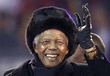 Former South African President Nelson Mandela waves to the crowd at Soccer City stadium during the closing ceremony for the 2010 World Cup in Johannesburg, in this July 11, 2010 file photo. REUTERS/Michael Kooren/Files