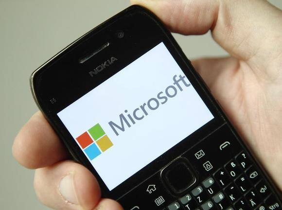 The Microsoft logo is displayed on a Nokia phone in Vienna September 3, 2013. REUTERS/Heinz-Peter/Files