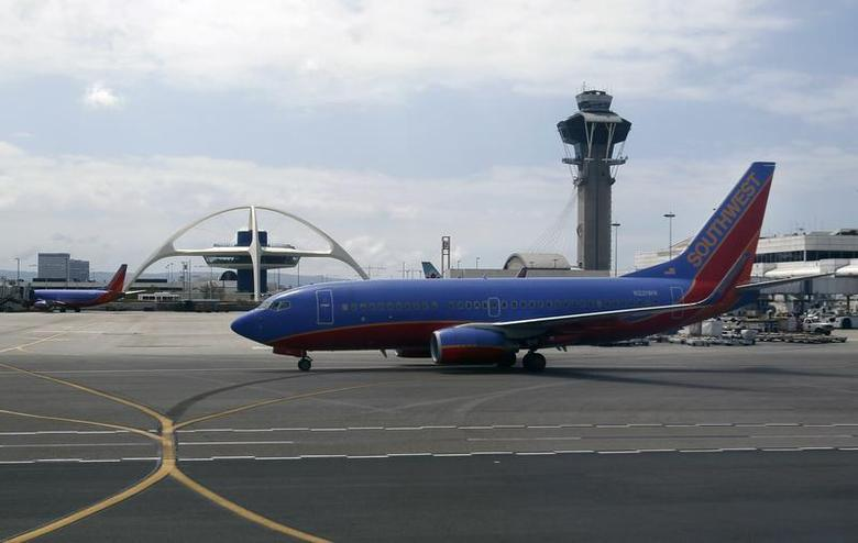 A Southwest Airlines Boeing 737NG plane taxies at Los Angeles International Airport (LAX) in Los Angeles, California, April 3, 2011. REUTERS/Hyungwon Kang