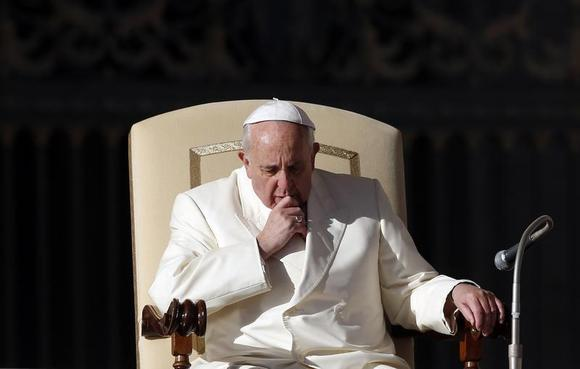 Pope Francis attends during his weekly general audience at St. Peter's Square at the Vatican December 4, 2013. REUTERS/Alessandro Bianchi