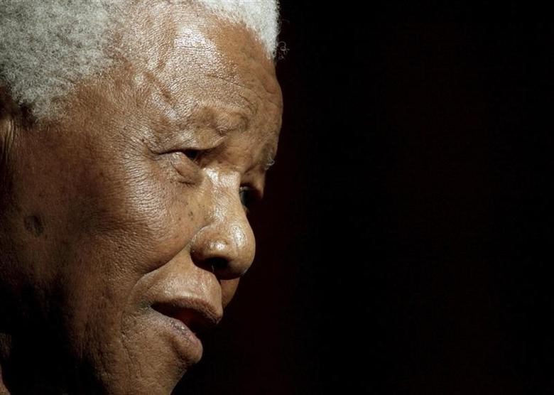 Former South African President Nelson Mandela speaks after being conferred with an Honorary Doctorate of Laws at the University of Galway in this June 20, 2003 file photo. REUTERS/Paul McErlane/Files
