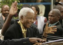 Former South African President Nelson Mandela waves as he leaves after casting his vote at a polling station in Houghton, Johannesburg, in this April 22, 2009 file photo. REUTERS/Siphiwe Sibeko