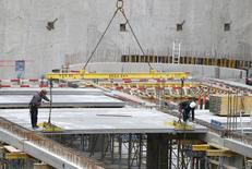 Workers are seen at a construction site of a building which will house apartments and offices in central Brussels November 26, 2013. REUTERS/Yves Herman