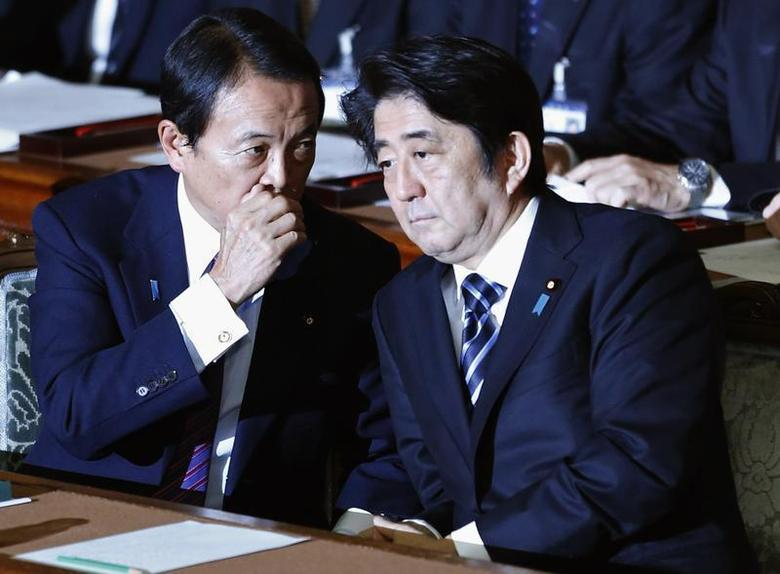 Japan's Prime Minister Shinzo Abe (R) listens to Deputy Prime Minister and Finance Minister Taro Aso during the plenary session of the Lower House of the parliament as it rejects a no-confidence resolution against the Cabinet, in Tokyo December 6, 2013. REUTERS/Yuya Shino