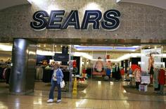 A customer leaves the Sears store in Denver February 26, 2009. REUTERS/Rick Wilking