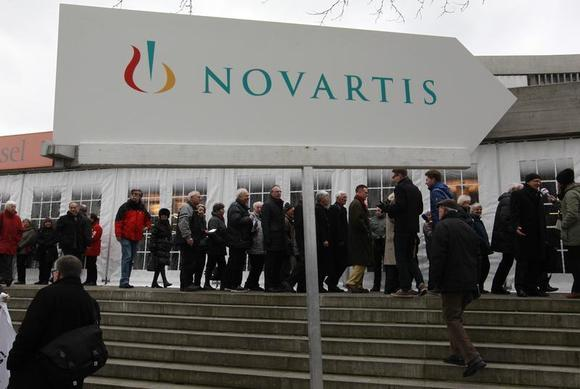 Shareholders queue to enter the St.Jakob Halle for Swiss drug maker Novartis annual general meeting in Basel February 22, 2013. REUTERS/Arnd Wiegmann