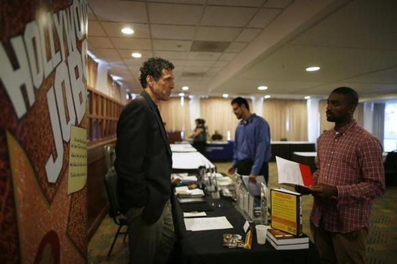 People speak to recruiters at a job fair in Los Angeles, California, November 18, 2013. REUTERS/Lucy Nicholson/Files