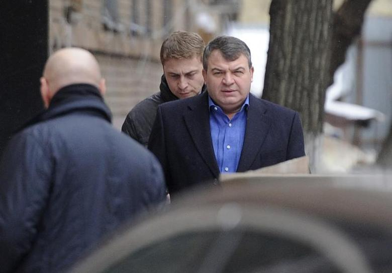 Former Russian Defence Minister Anatoly Serdyukov (R) arrives by a back entrance for questioning by investigators in Moscow December 3, 2013. REUTERS/Anton Tarasov