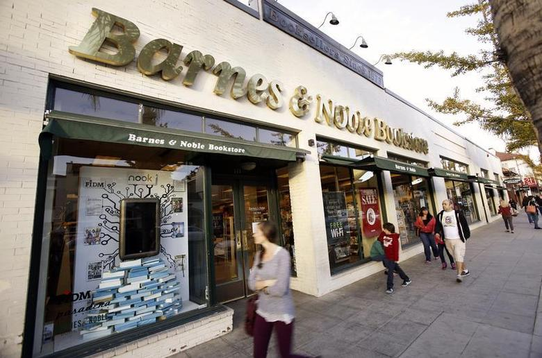 People walk by a Barnes & Noble bookstore in Pasadena, California November 26, 2013. REUTERS/Mario Anzuoni