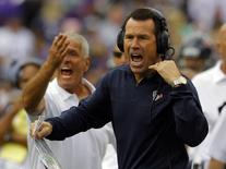 Houston Texans head coach Gary Kubiak yells to his team during their NFL football game against the Baltimore Ravens in Baltimore, Maryland September 22, 2013. REUTERS/Richard Clement