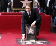Film and television producer Jerry Bruckheimer poses with his star on the Hollywood Walk of Fame in Hollywood June 24, 2013. REUTERS/Fred Prouser