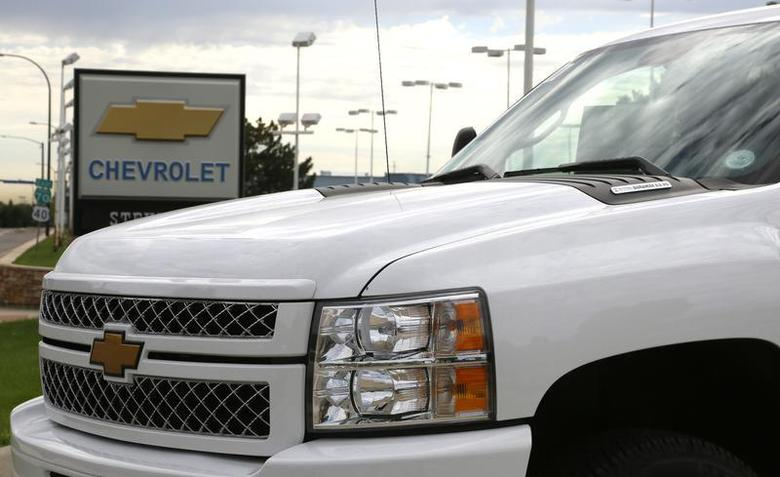 The sign at a General Motors Chevrolet dealer is seen behind a Chevrolet pickup truck in Golden, Colorado September 4, 2013. REUTERS/Rick Wilking