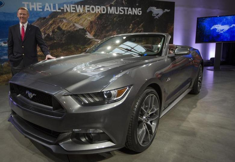 Ford Motor Co. CEO Alan Mulally unveils its all new 2015 Ford Mustang GT at an event in New York December 5, 2013. REUTERS/Brendan McDermid