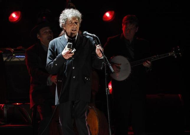 Singer Bob Dylan performs during a segment honoring Director Martin Scorsese, recipient of the Music+ Film Award, at the 17th Annual Critics' Choice Movie Awards in Los Angeles January 12, 2012. REUTERS/Mario Anzuoni