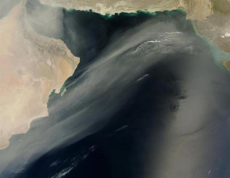This image released by NASA April 4, 2011, from its Terra satellite shows a thick wall of dust that blew across the Arabian Peninsula March 25-27, 2011, had thinned into an ethereal plume that extended across the Arabian Sea by the time the Moderate Resolution Imaging Spectroradiometer (MODIS) on NASA's Terra satellite captured this image on March 30. REUTERS/Jeff Schmaltz, MODIS Rapid/NASA/Handout