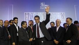 Director-General Roberto Azevedo gestures as he is congratulated by delegates after the closing ceremony of the ninth World Trade Organization (WTO) Ministerial Conference in Nusa Dua, on the Indonesian resort island of Bali December 7, 2013. REUTERS/Edgar Su