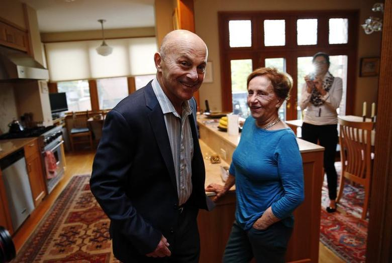 University of Chicago Professor Eugene Fama is pictured in his house with his wife Sally after finding out he won the 2013 Nobel Prize in Economics in Chicago, Illinois October 14, 2013. REUTERS/Jim Young