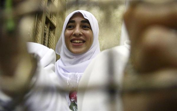 Mona al-Beltagy, who was found guilty along with other women and girls of obstructing traffic during a pro-Islamist protest in October, smiles during an appeal hearing at a court in the Mediterranean city of Alexandria, 230 km (143 miles) north of Cairo December 7, 2013. REUTERS-Stringer