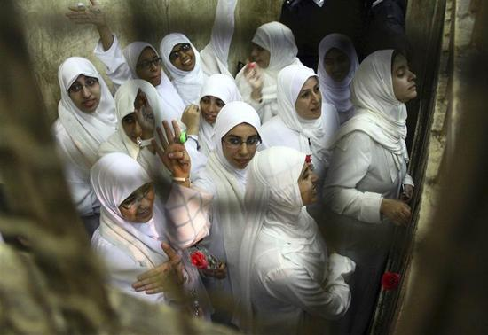 Women, who were found guilty of obstructing traffic during a pro-Islamist protest in October, gesture during their appeal hearing at a court in the Mediterranean city of Alexandria, 230 km (143 miles) north of Cairo December 7, 2013. REUTERS-Stringer