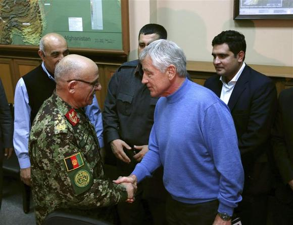U.S. Secretary of Defense Chuck Hagel (R) shakes hands with Afghan General Sher Mohammad Karimi during a meeting at the International Security Assistance Force (ISAF) headquarters in Kabul December 7, 2013. REUTERS/Mark Wilson/Pool