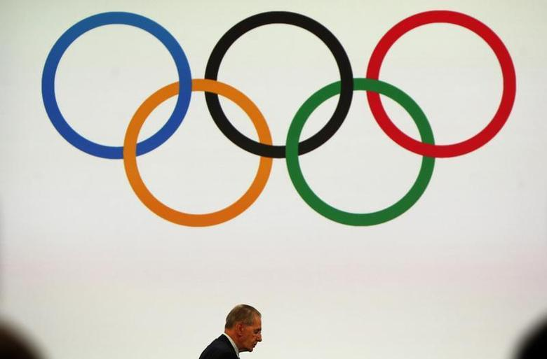 President of the International Olympic Committee (IOC) Jacques Rogge (L) attends the board session in Buenos Aires September 8, 2013. REUTERS/Marcos Brindicci