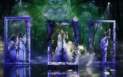 "Contestant Jennifer Grout of the U.S. performs during the Season 3 finale of ""Arabs Got Talent"" in Zouk Mosbeh area, north of Beirut December 7, 2013. REUTERS/Mohammed Azakir"