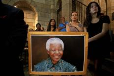 People attend a special Sunday morning service dedicated to Nelson Mandela at St. George's Cathedral in Cape Town December 8, 2013. REUTERS/Mark Wessels