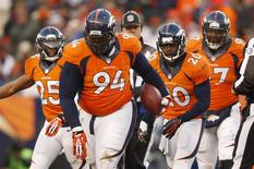 Dec 8, 2013; Denver, CO, USA; Denver Broncos defensive tackle Terrance Knighton (94) after catching an interception during the second half against the Tennessee Titans at Sports Authority Field at Mile High. The Broncos won 51-28. Mandatory Credit: Chris Humphreys-USA TODAY Sports