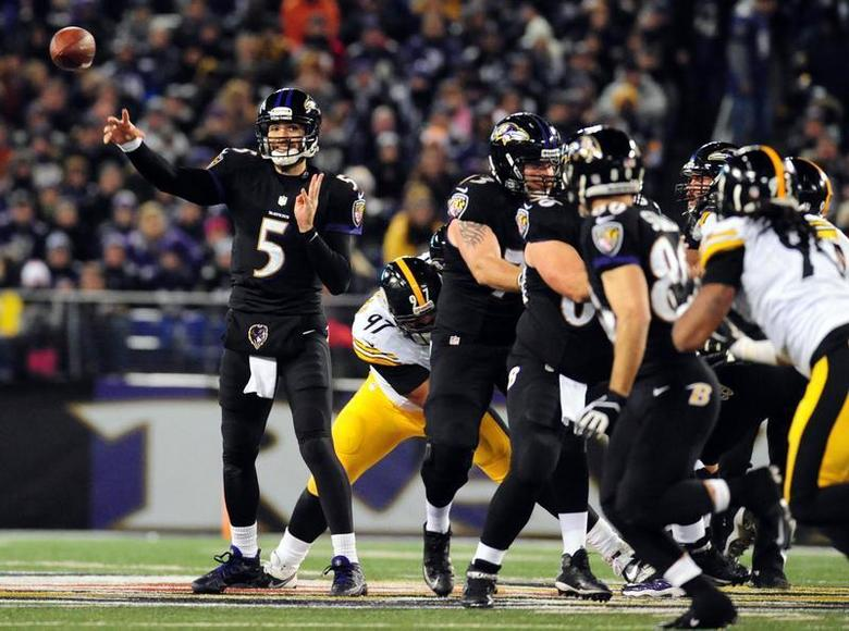 Nov 28, 2013; Baltimore, MD, USA; Baltimore Ravens quarterback Joe Flacco (5) throws a pass against the Pittsburgh Steelers during a NFL football game on Thanksgiving at M&T Bank Stadium. Mandatory Credit: Evan Habeeb-USA TODAY Sports - RTX15X1Y