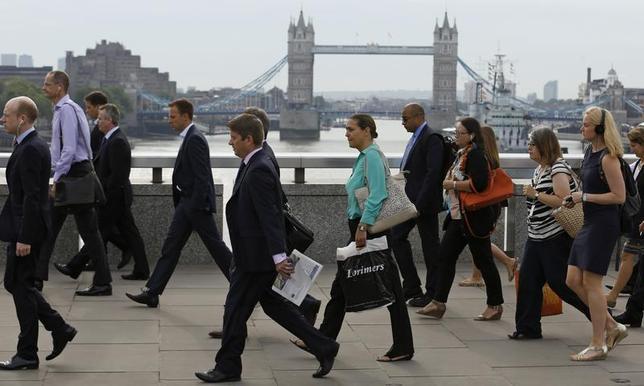 Commuters walk across London Bridge to the City of London August 7, 2013. REUTERS/Luke MacGregor