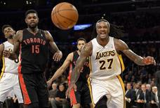 Dec 8, 2013; Los Angeles, CA, USA; Los Angeles Lakers center Jordan Hill (27) and Toronto Raptors power forward Amir Johnson (15) watch as the ball bounces out of bounds during the second half at Staples Center. Mandatory Credit: Richard Mackson-USA TODAY Sports