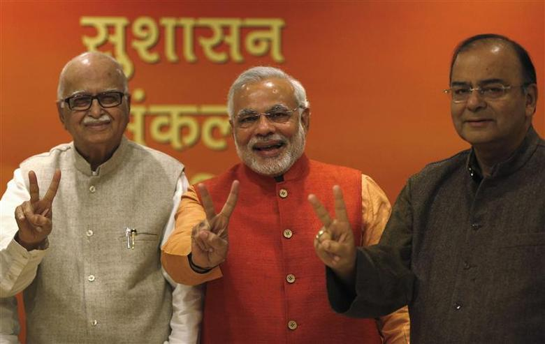 (From L - R) India's main opposition Hindu-nationalist Bharatiya Janata Party (BJP) leader Lal Krishna Advani, Gujarat's chief minister and Hindu nationalist Narendra Modi, the prime ministerial candidate for BJP and leader Arun Jaitley show victory signs before their meeting in New Delhi December 8, 2013. REUTERS/Ahmad Masood