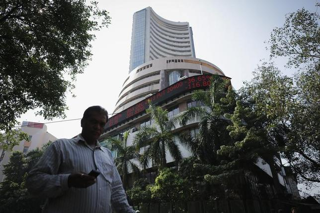 A man walks past the Bombay Stock Exchange (BSE) building in Mumbai December 5, 2013. REUTERS/Danish Siddiqui/Files